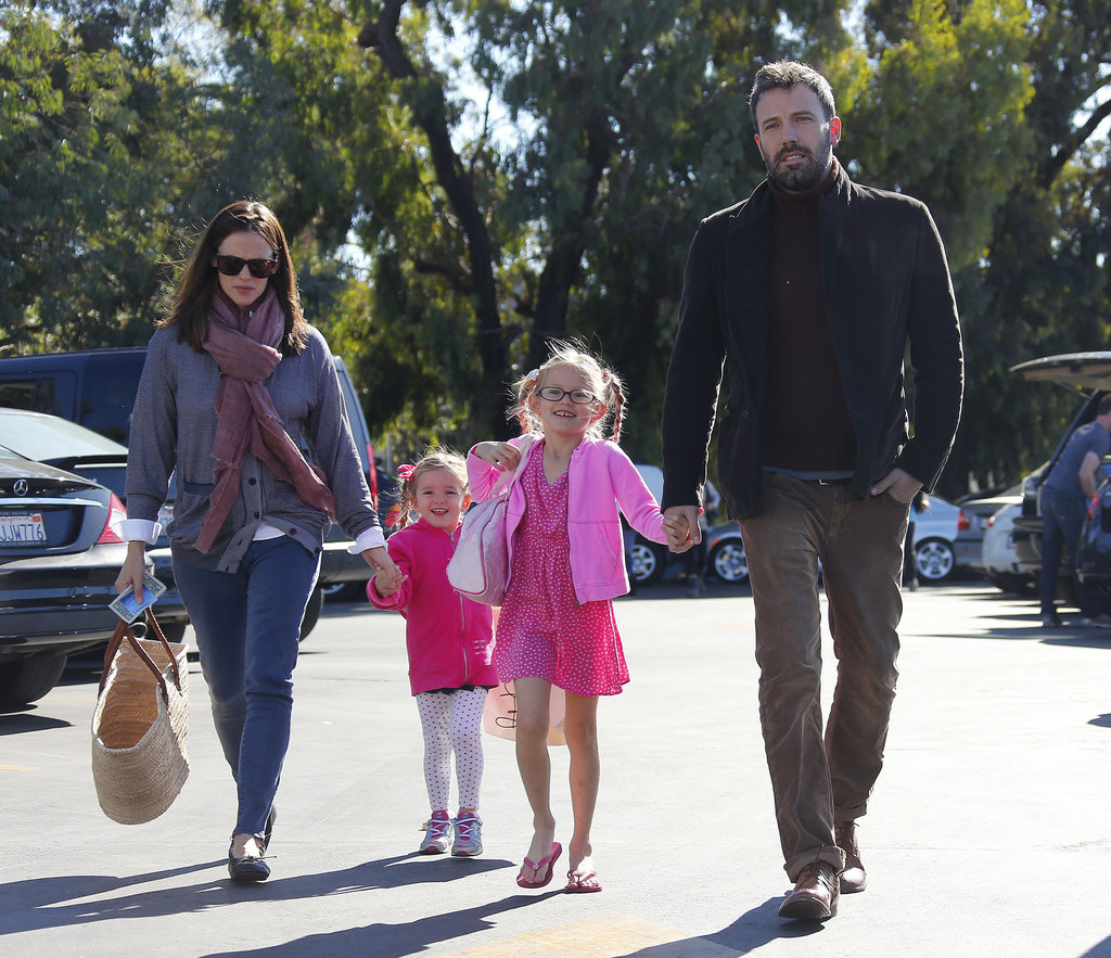 Jennifer Garner and Ben Affleck kept a firm hold on their daughters Violet and Seraphina at a market in LA on November 11.