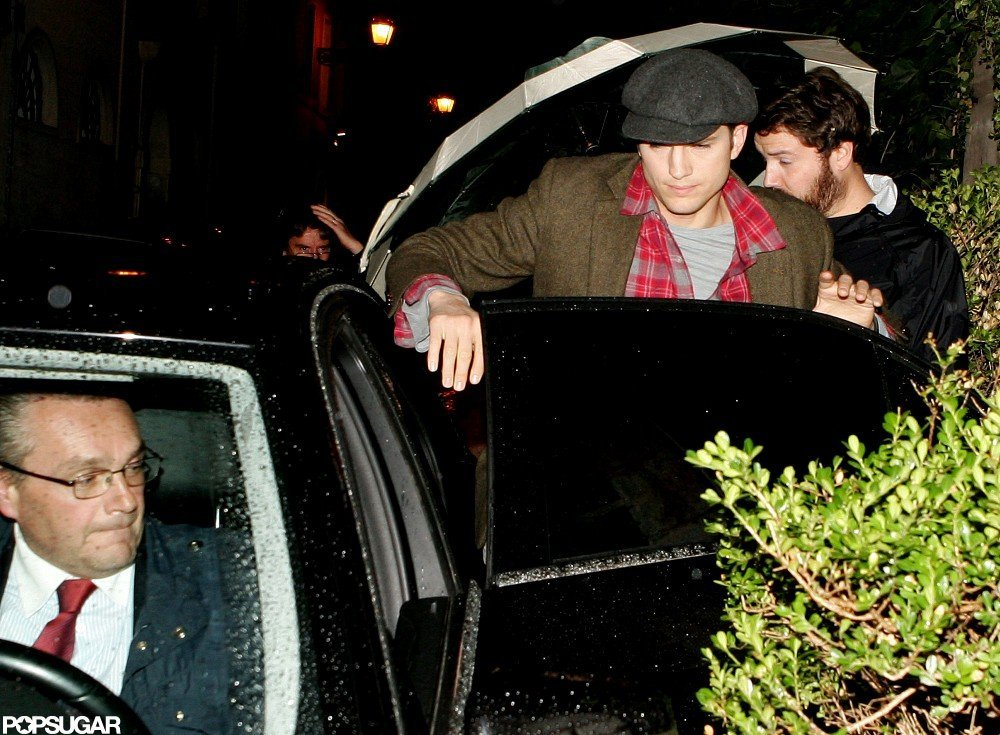 Ashton Kutcher stepped out in a green coat in Rome.