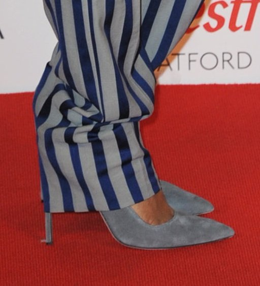 Rihanna tempered her menswear look with grey suede peep-toe pumps.