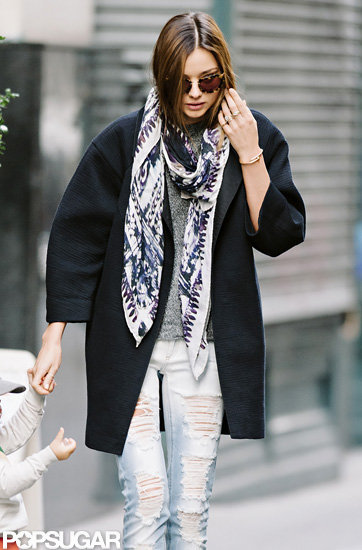 Miranda Kerr wore a scarf and ripped denim for an outing in NYC.