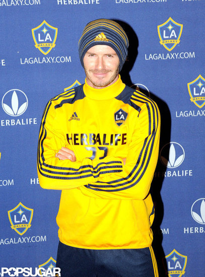David Beckham posed for photos in an LA Galaxy shirt.