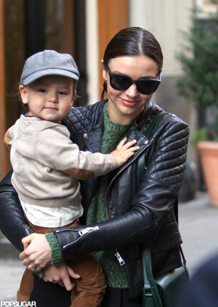 Miranda Kerr smiled as she held Flynn Bloom in NYC.