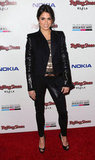 Nikki Reed celebrated at the AMAs afterparty in a slick leather-sleeved blazer.