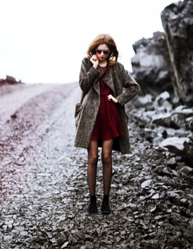 This styler gave cold-weather gear a cooler contrast with mirrored sunglasses. Source: Lookbook.nu
