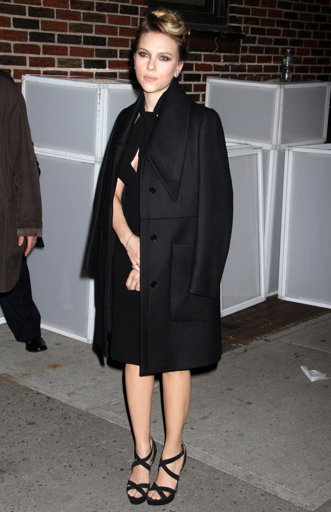 Scarlett Johansson kept it classic in a black Giambattista Valli coat while promoting Hitchcock.