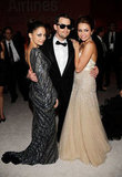 Miley rubbed shoulders with Nicole Richie and Joel Madden at Elton John's Oscars party in Mar. 2010.