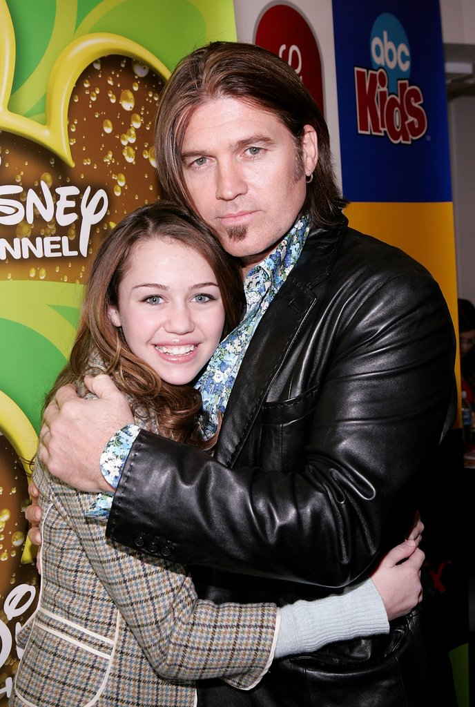 Miley Cyrus hugged her dad, Billy Ray Cyrus, at an event in Feb. 2006.