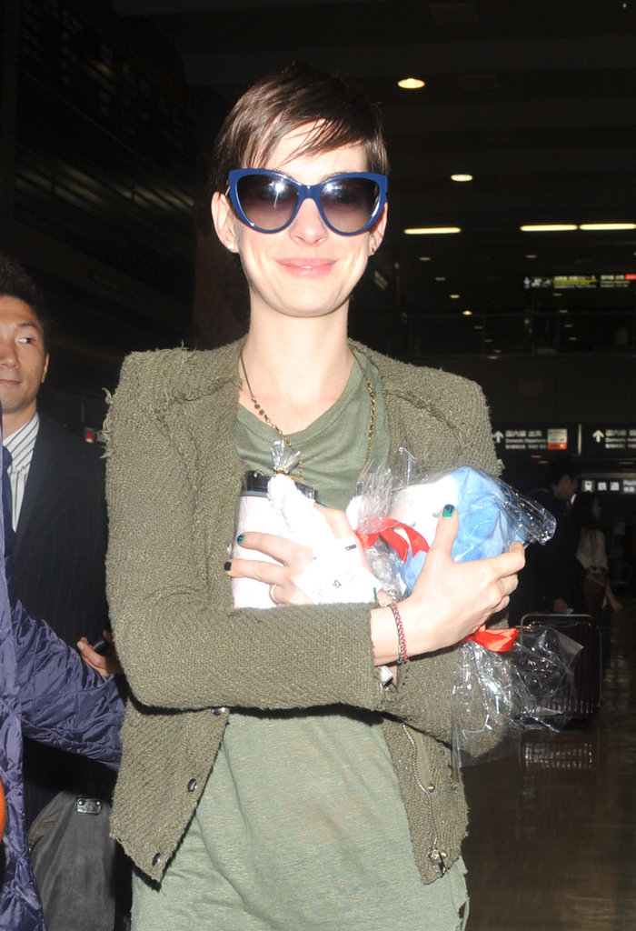 Anne Hathaway held a toy.