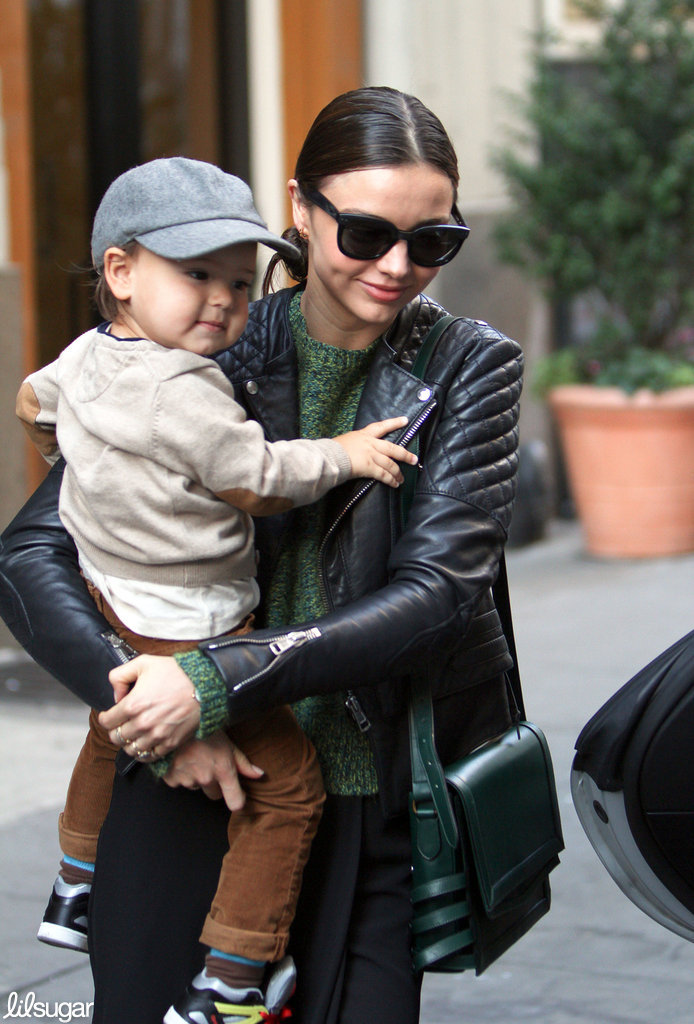Flynn Bloom had a smile on his face as mom Miranda Kerr carried him out of their NYC apartment.