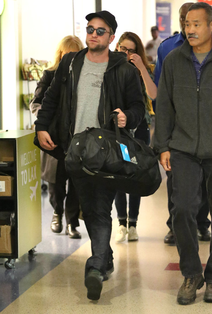Robert Pattinson carried his bag through LAX.