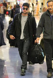 Robert Pattinson arrived on a flight at LAX.