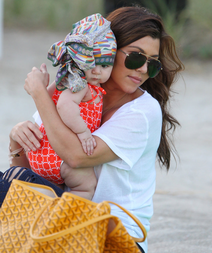 Penelope Disick wore a head scarf with her mom, Kourtney Kardashian.