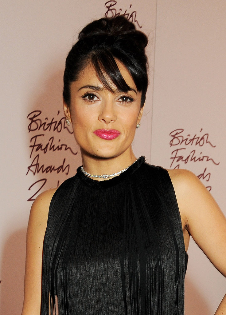 Salma Hayek wore her hair up in a high bun for the British Fashion Awards in London.