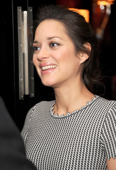 Marion Cotillard wore a black and white dress.