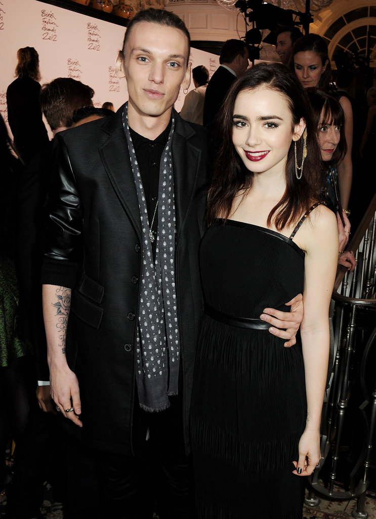 Lily Collins arrived with Jamie Campbell Bower for the British Fashion Awards in London.