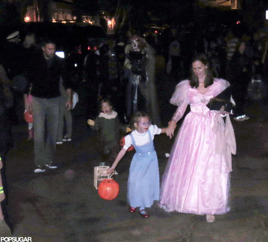 The Garner-Afflecks celebrated Halloween as a family, dressing up as characters from The Wizard of Oz and trick-or-treating in their LA neighborhood.