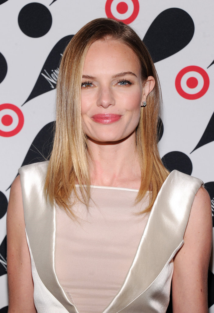 Kate Bosworth wore a white silk dress with a sheer panel in the front.