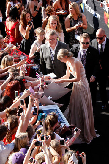 Taylor Swift signed autographs for fans as she made her way into the Aria Awards in Sydney.