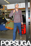Liam Hemsworth caught an outbound flight from LAX.
