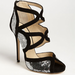 Jimmy Choo's sequined Tempest sandals ($597, originally $995) will have everyone gawking at your feet wherever you strut.