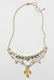 I love how sweet and colorful this Noronha Bib Necklace ($58) is. It has the personality of a great little treasure you might find at the flea market, something you'll mix and match and layer up with your other necklaces — it's just so pretty.