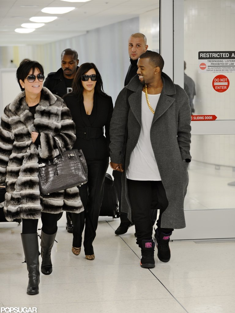 Kim Kardashian and Kanye West landed at LAX after their pregnancy announcement.