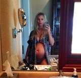 Jessica Simpson Models Her New Baby Bump in a Bikini