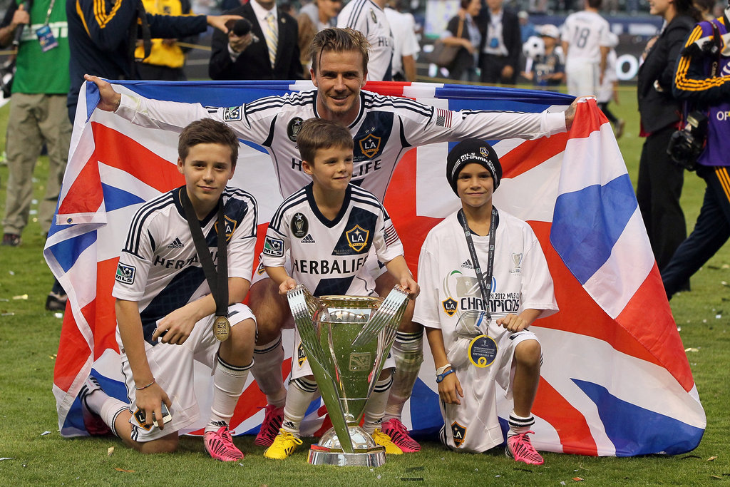 David Beckham's last game with the LA Galaxy ended with his team's winning the MLS Cup, and he celebrated with sons Brooklyn, Romeo, and Cruz.