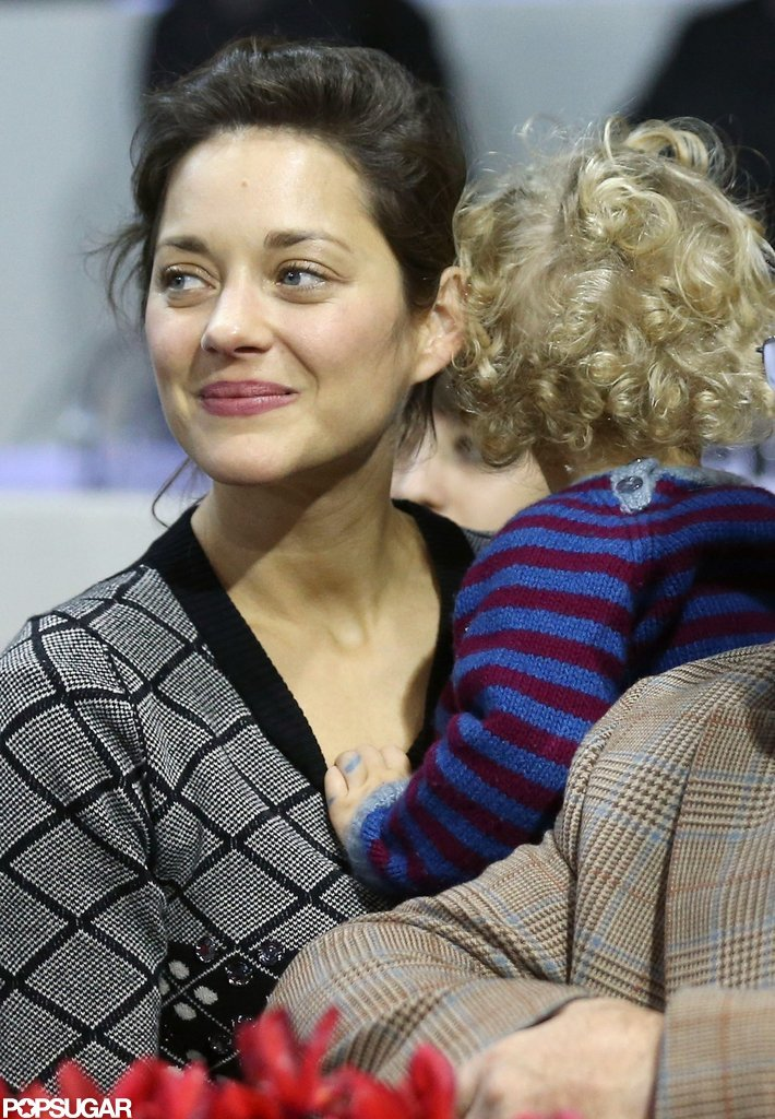 Marion Cotillard held her son, Marcel Canet, on her lap at the Paris Masters.