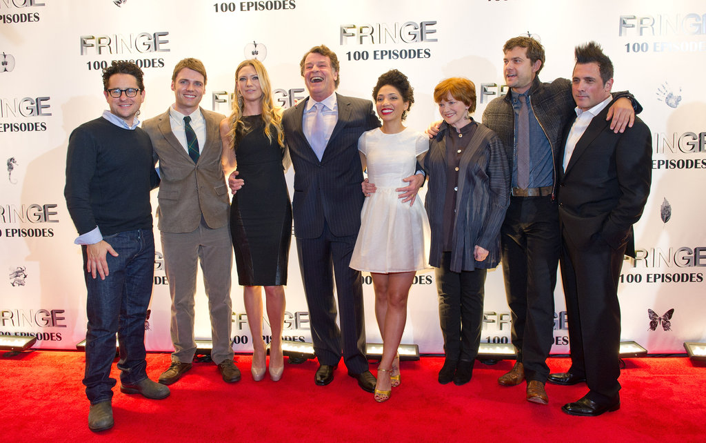 Cast and crew of Fringe smiled for photos at the Fringe100 episodes and final season party in Vancouver.