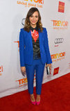 Rashida Jones went for colour in a big way here, wearing a printed blouse with a bright blue pantsuit and neon pink heels.