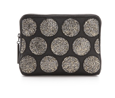 This 3.1 Phillip Lim dotted crystal clutch ($650) is so whimsical. We love that it gives off subtle shine.