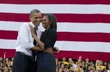 The president and first lady were all smiles in Iowa City during a September campaign event.