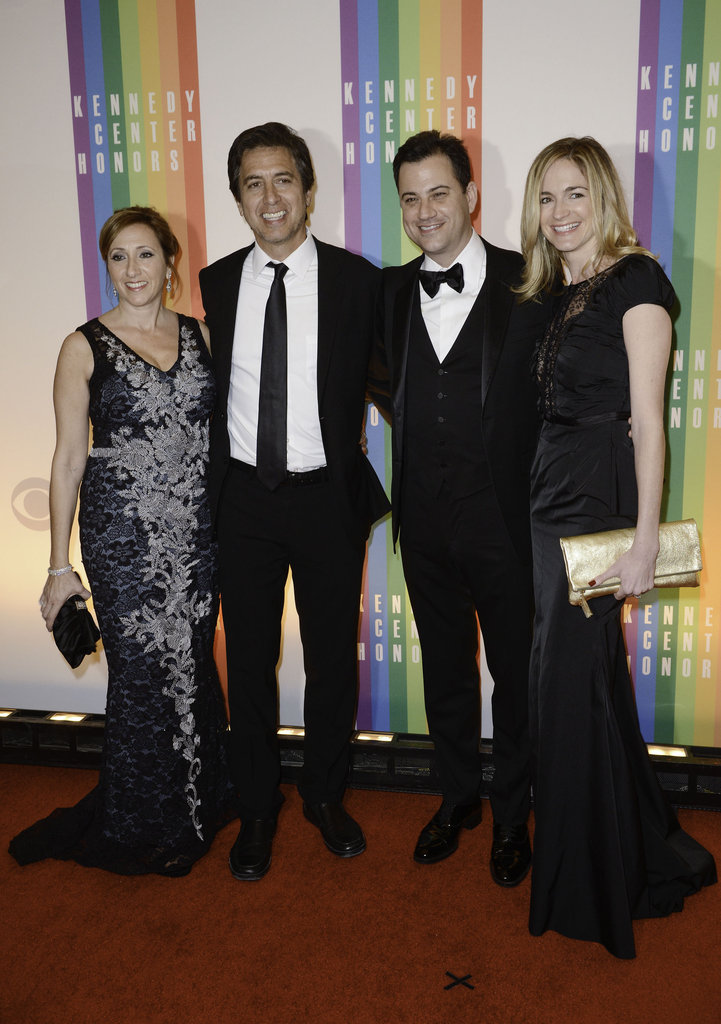 Anna Romano, Ray Romano, Jimmy Kimmel, and Molly McNearney stopped on the red carpet for a group picture.