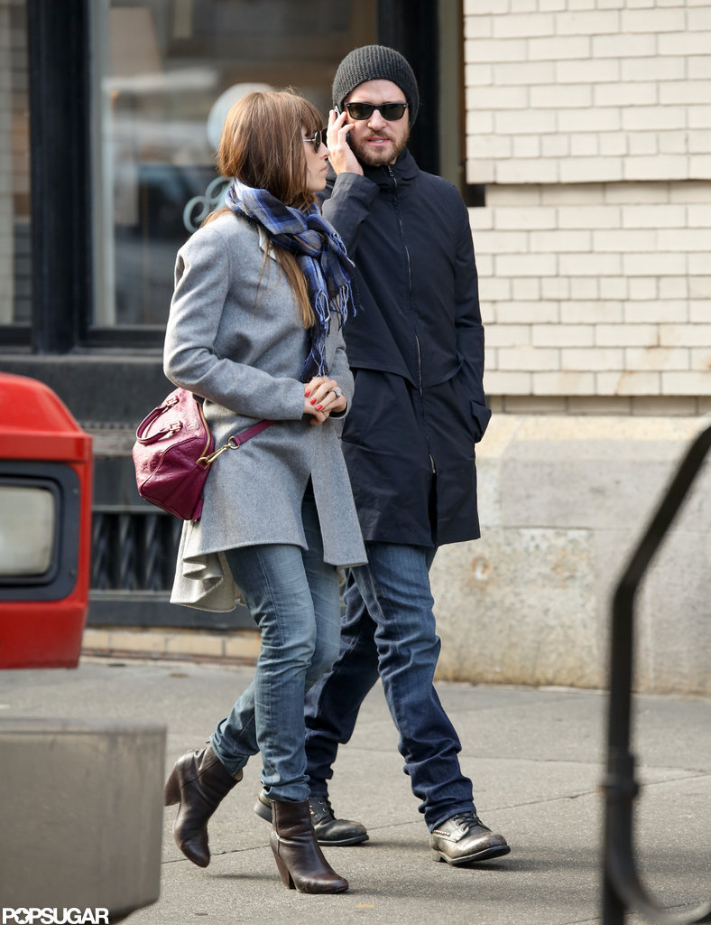 Justin Timberlake talked on the phone during a walk with Jessica Biel.