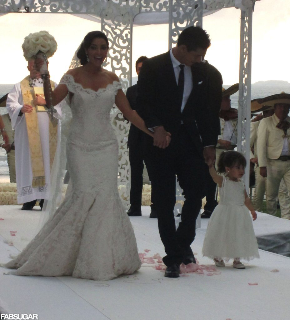 Mario Lopez and Courtney Mazza tied the knot in Punta Mita, Mexico in 2012, and the blushing bride wore a sweeping Chantilly lace gown by Ines Di Santo.