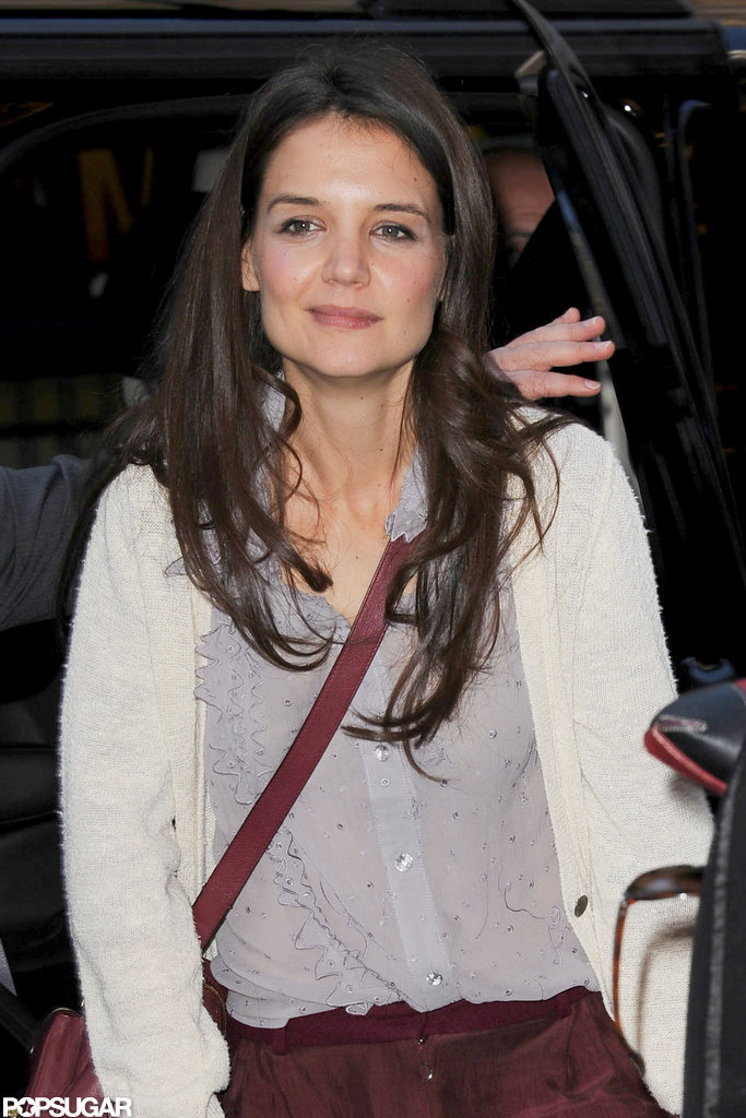 Katie Holmes kept warm in a light sweater.