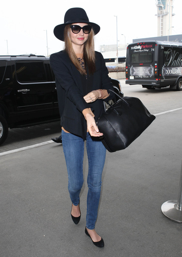 Miranda Kerr Skips the VS Viewing Party For a Stylish Flight
