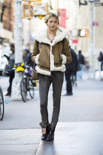 How cozy does she look?! We need that shearling jacket. Source: Adam Katz Sinding