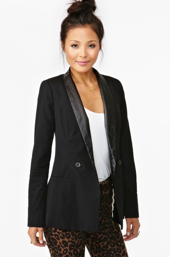 It's a cool and classic finish to party dresses, pants, and skirts, so you'll wear this Nasty Gal Moto Tux Blazer ($78) all season long.