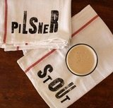 This hand-stamped Towel Set ($24) is a great gift for the home brewer or beer lover.