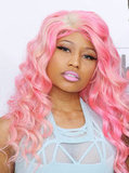 For the 2011 Bilboard Music Awards, Nicki stuck to a strawberries-and-cream palette, matching her lipstick to her soft pink waves.