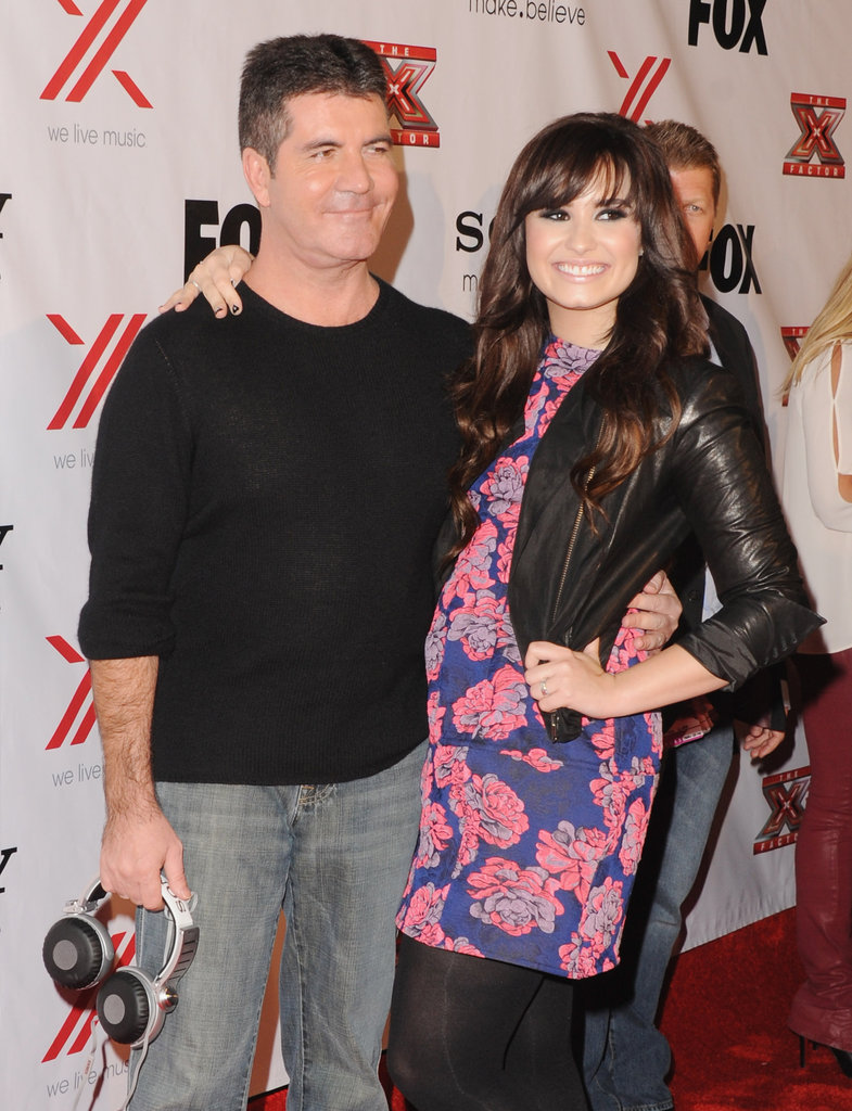 Demi Lovato posed for a photo with Simon Cowell.
