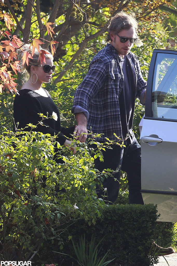 A possibly pregnant Jessica Simpson went house hunting with fiancé Eric Johnson.