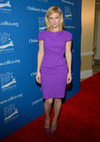 Alice Eve chose a classic sheath in a brilliant lilac hue and a pair of suede platforms.