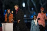 Sasha Obama held her dad's hand at the national Christmas tree lighting.