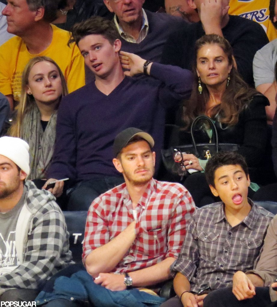 Maria Shriver sat behind Andrew Garfield.