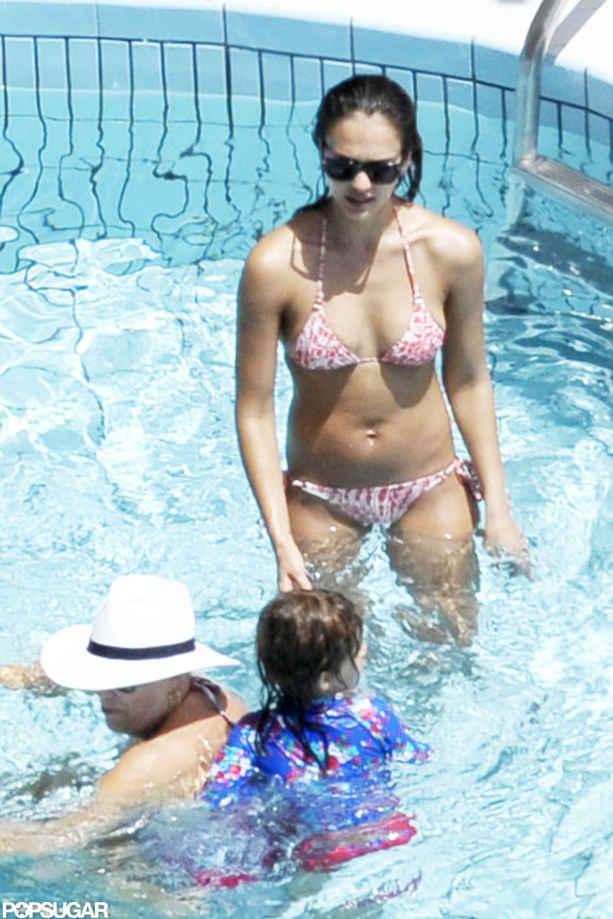 In July 2012, Jessica Alba played in the pool with her daughters, Honor and Haven, while on vacation in Amalfi, Italy.