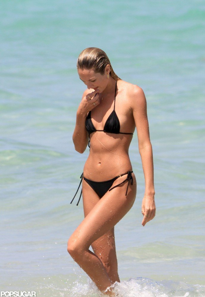 Victoria's Secret model Candice Swanepoel showed off her covetable bikini body while in Miami with friends this July.