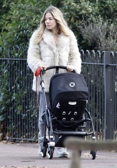 Sienna Miller wore a cream fur coat in London.
